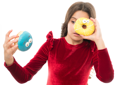 Kid girl hungry for sweet donut. Sugar levels and healthy nutrition. Donut her sweet obsession. Happy childhood and sweet treats. Donut breaking diet concept. Girl hold glazed donut white background.