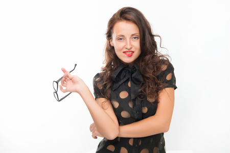 Pretty school teacher or student. Fashion and beauty. Business school coach. Dress code. Sexy businesswoman. Back to school. Girl with red lips in glasses. Work hard play hard. Concentrated on exam. Stock Photo