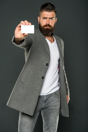 Banking and credit concept. Plastic bank card. Easy money credit. Which bank card easy to get. Easy shopping. Credit card gives you freedom and confidence. Man bearded hipster hold plastic blank card.