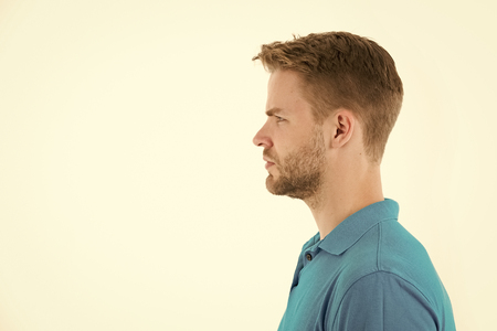 Man with beard on unshaven face in profile. Bearded man in blue tshirt. Fashion model with stylish hair isolated on white. Skincare and barber salon. Style or trend and hairstyle concept, copy space.