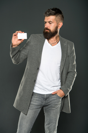 Plastic bank card. Easy money credit. Which bank card easy to get. Easy shopping. Credit card gives you freedom and confidence. Man bearded hipster hold plastic blank card. Banking and credit concept.