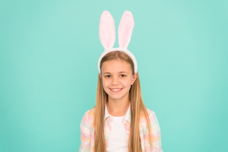 Looking top notch for Easter. Small girl child in easter bunny style. Cute little girl wearing bunny ears headband. Fashion accessory for easter costume party. Looking pretty in easter bunny attire. Reklamní fotografie