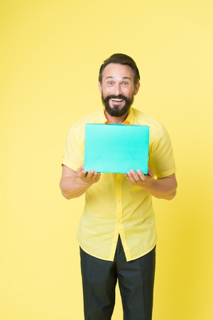 Man emotional enjoying shopping. Bearded mature man with shopping bag on yellow background. Sale and discount. Online shopping. Profitable purchase. Shop assistant or sales expert. Shopping happiness.