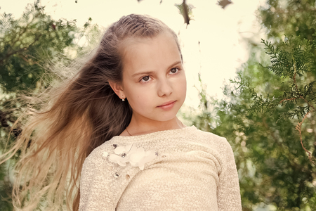Portrait of a lovely little happy princess girl with long blonde curly hair at summer sunny day Reklamní fotografie