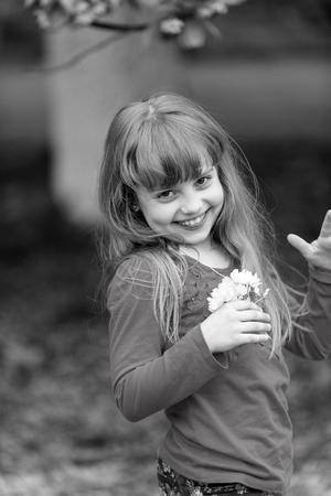 Beauty, look, hair, hairstyle Beauty kid with sakura flowers Reklamní fotografie
