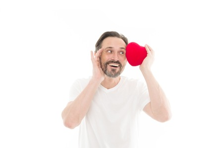secret attraction. Valentines day. Health care. heart transplant. Holiday celebration. Love. problems with heart. Man with beard. Decorative for valentines day. Mature bearded man with red heart.