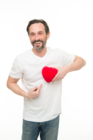 Valentines day. Health care. Mature bearded man with red heart. heart transplant. Holiday celebration. Love. problems with heart. Man with beard. Decorative for valentines day. I believe in love. Reklamní fotografie