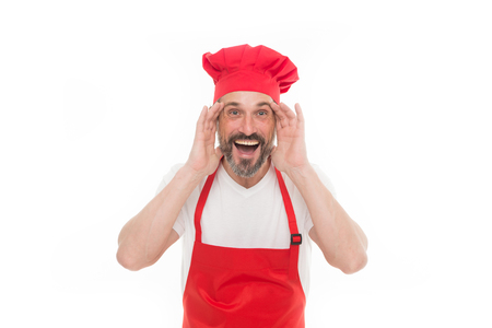 Can you hear me. Bearded mature man in chef hat and apron. Senior cook with beard and moustache wearing bib apron. Mature chief cook in red cooking apron. Home cooking.