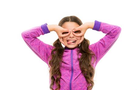 Cheerful grimace. Girl holding fingers like glasses mask superhero or owl. Play game with mask superhero. Child cheerful mood grimace with mask. Pretend be fantastic hero. Kid hide face finger mask. Reklamní fotografie
