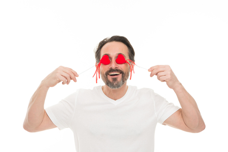 Just happy. Mature bearded man with red heart. Love. problems with heart. Man with beard. Decorative for valentines day. heart transplant. Holiday celebration. Valentines day. Health care. Reklamní fotografie