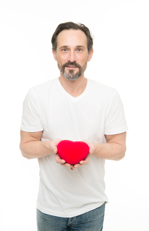Love is in the air. Mature bearded man with red heart. Love. problems with heart. Man with beard. Decorative for valentines day. heart transplant. Holiday celebration. Valentines day. Health care. Reklamní fotografie