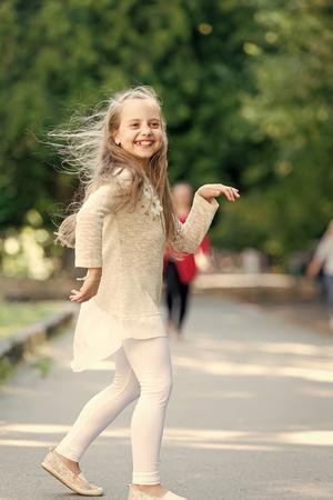 Cute little girl dancing at the street at summer day Reklamní fotografie