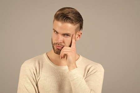 Man with beard on thinking face. Bearded man with blond hair. Skincare and barber salon. Fashion model on grey background. Fashion style and trend concept.