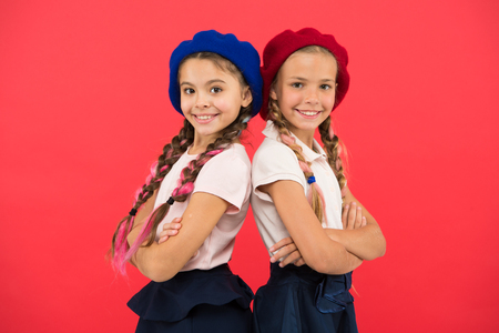 Apply form enter international school. French language school. School fashion concept. Pupil smiling girls wear formal uniform and beret hats. International exchange school program. Education abroad.