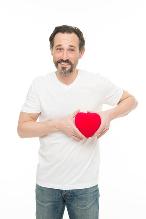 Preventing heart attack. Valentines man holding red toy heart in hands. Handsome mature man with valentines day heart. Heart problem and healthcare. Maybe this heartache will be good for him. Stok Fotoğraf