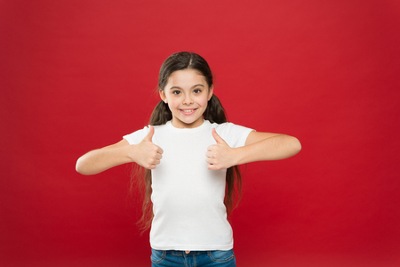 That is right. Little girl excited smiling face. Kid happy cute face feels excited red background. Exciting moments. Excitement emotion. Sincere excitement. Kid girl long hair wear casual clothes.