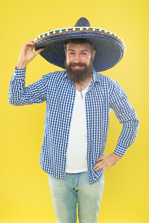 Great party hat. Traditional fashion accessory for mexican costume party. Bearded man in mexican hat. Hipster in wide brim hat. He is in love with mexican style. Mexican man wearing sombrero.