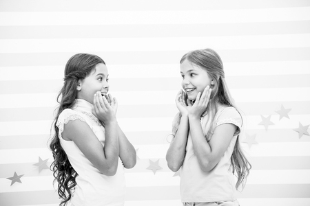 Amazing surprising news. Girls excited expression. Girls kids just heard amazing news. Surprised children excited about rumors. Secret little lies or gossips. Girlish gossip. Exciting rumor or news. Imagens