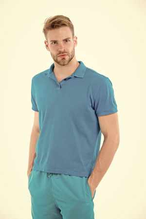 Sport fashion style and trend. Man in tshirt and shorts isolated on white background. Bearded man in blue casual clothes. Macho in active wear for workout or training. Fitness and gym activity.