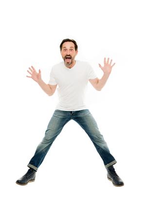 L'uomo ha eccitato il salto. Oratore carismatico maturo entusiasta di informare. Pieno di eccitazione. Ragazzo emotivo felice. Buone notizie. Espressione del viso eccitato. Non può nascondere l'eccitazione. Esplosione di emozioni positive.