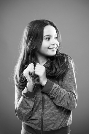 Kid girl long healthy shiny hair. Main thing is keeping it clean. Use gentle shampoo and warm water. Little girl grow long hair. Teaching child healthy hair care habits. Strong hair concept. Reklamní fotografie