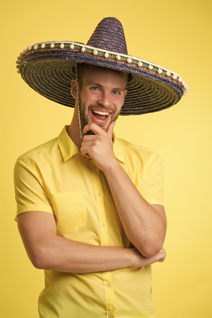 Happy guy smile in sombrero hat. Male fashion. Always in good mood. Mexican style. Mexico. Traditional clothes. theme party. Handsome and stylish man. Confidence and charisma.