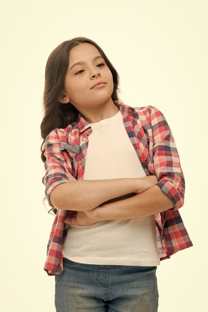Problem solved. Girl confident face feels superiority. Girl folded arms on chest looks cool, isolated white background. Kid enjoy her superiority or fame. Childs arrogant behaviour.