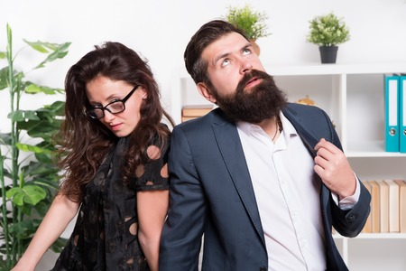Tired man with beard and sexy woman. Young coworkers. Businesspeople. Teamwork. Business couple in office. Formal fashion dress code. Overtime. Tired from work. Tired office worker. feeling tired.