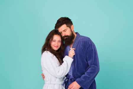 Sleepy man embrace his girl. Bearded man and woman in robe pajama. Couple in love. sleepy family. Wake up morning. Love and romance. Happy family in morning. couple looks sleepy in morning. Insomnia.