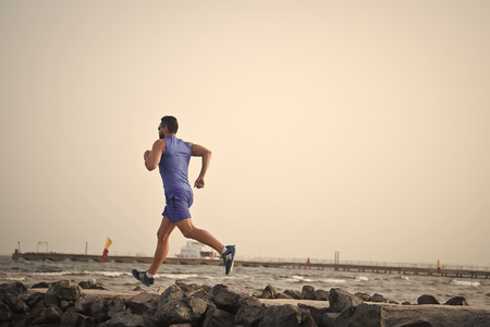 Run to success. success in sport of man run. out for a run. full of energy. success run of sportsman. runner is going to success, copy space