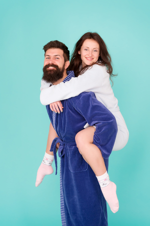 Good morning. Wake up in morning. Couple in love. Family. Love and romance. Happy family in morning. Bearded man and woman in robe. Morning tradition. Cheerful couple. Never boring. family couple fun. Stock Photo