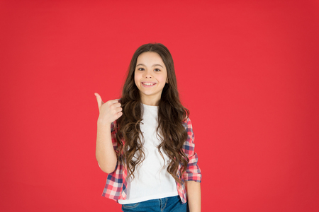 Recommend something. This is awesome. Girl cute child show thumbs up gesture. Teens totally love. Kid show thumbs up. Girl happy totally in love fond of or highly recommend. Thumbs up approvement. Banco de Imagens
