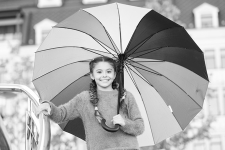 Ways brighten your fall mood. Colorful accessory for cheerful mood. Girl child long hair ready meet fall weather with umbrella. Stay positive fall season. Colorful fall accessory positive influence. Stok Fotoğraf