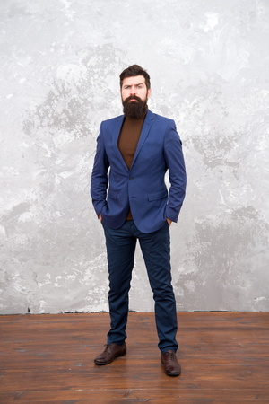 Classy style. Man bearded hipster wear classic suit outfit. Formal outfit. Take good care of suit. Elegancy and male style. Businessman or host fashionable outfit grey background. Fashion concept. Stock Photo - 123519531