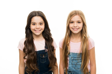 These stunning looks. Cute little girls wearing new hairstyle. Adorable small girls with long hairstyle. Beauty and hair salon. Kids hair care and grooming. Natural hair styling and dressing.