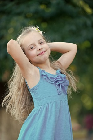 Child smile with long blond hair, hairstyle. Child, childhood, innocence youth concept