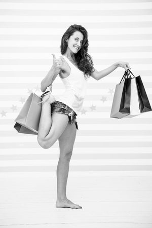 happy girl show thumb up for shopping benefit. happy girl with shopping bags. sale benefit and special offer. beautiful shopaholic woman. overjoyed woman with paperbag. Plan your purchases in advance.