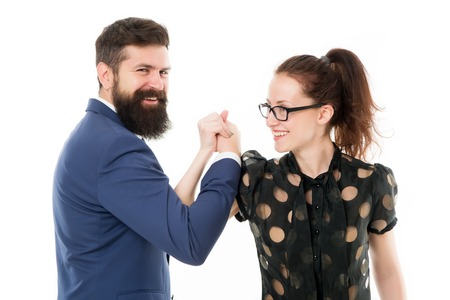 Strong team. Couple colleagues man with beard and pretty woman on white background. Business partners leadership and cooperation balance. Office job and business. Business and teamwork concept.