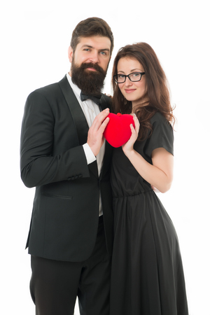 Couple in love. Family couple. Formal couple with red heart. Love romance. Couple on love date. Bearded man in tuxedo hug elegant woman in glasses. Valentines day. Proposal and engagement. as a whole 免版税图像