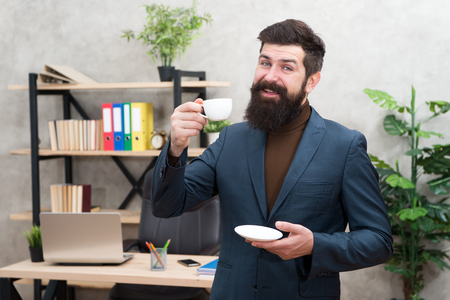 Businessman in formal outfit. Morning coffee. Confident happy man use laptop. Boss workplace. Coffee break. Happy businessman. Bearded man in business office. Happy morning coffee. Team leader.