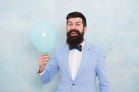Lets have fun. Man groom blue tuxedo bow tie hold air balloon. Wedding fun. Groom bearded hipster having fun with air balloon. My happy day. Happy guy in cheerful mood. Fun and happiness concept. Stock Photo