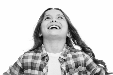 Emotions concept. Sincere emotional child. Girl laugh emotional face. Humor and react funny story. Childhood and happiness concept. Kid with cheerful face and brilliant smile isolated on white.