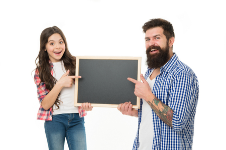 Happy family. Bearded man father with daughter. Little girl love father. Family day. Little girl with school blackboard. Father and child hold empty board. copy space. Home schooling. back to school.