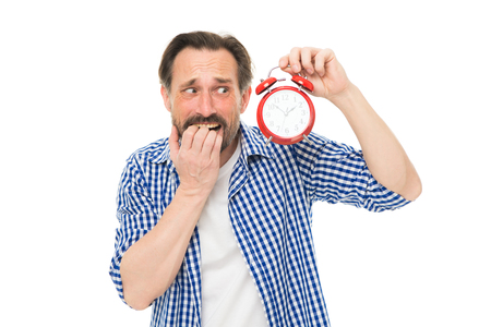 Being late. Stressed senior man worry being behind time. Bearded man with clock and stress on face. Mature timekeeper with clock. Mature man holding alarm clock. Scheduling time. Feeling stress.