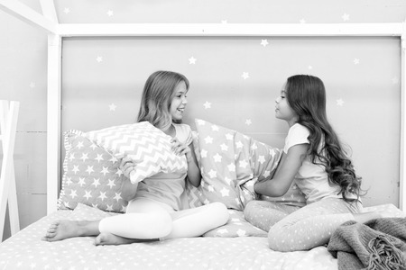 Girls happy best friends sleepover domestic party. Sleepover time for fun gossip story. Best girls sleepover party ideas. Soulmates girls having fun sleepover party. Childhood friendship concept. Stock Photo