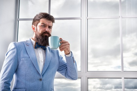But first coffee. Man groom drinking coffee early in morning. Beginning of great day. Important day in his life. Get ready. Enjoy every minute. Hipster in tuxedo with bow tie making sip of coffee.