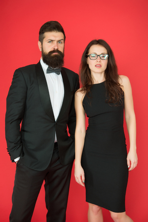 Formal dress code. Official event concept. Man bearded wear tuxedo girl elegant dress. Visiting event or ceremony. Couple classy clothes. Elite event. Main rules picking clothes. Corporate party. Фото со стока