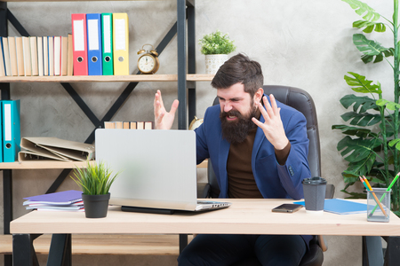 Got into mess. Man bearded boss manager sit office with laptop. Manager solving business problems online. Business man failed. Risky business. Broker and financial indicators. Falling stock prices. Stok Fotoğraf