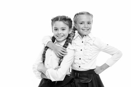 School fashion concept. Be bright. School friendship. Sisterhood relationship and soulmates. On same wave. Schoolgirls wear formal school uniform. Sisters little girls with braids ready for school Stock Photo