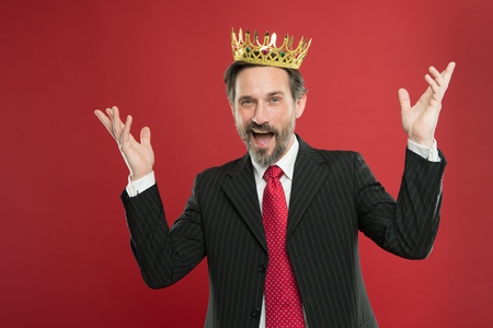 Superior and narcissistic. Become king ceremony. I am just superior. Award and achievement. Feeling superiority. Being superior human. Man bearded guy in suit hold golden crown symbol of monarchy